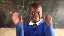 school girl in Kenya leading in song