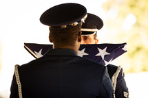 "Soldiers stand at attention during flag presentation at veteran's graveside ceremony. ""On behalf of the President of the United States, (the United States Army; the United States Marine Corps; the United States Navy; or the United States Air Force), and a grateful Nation, please accept this flag as a symbol of our appreciation for your loved one's honorable and faithful service."""
