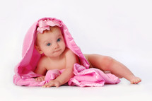 infant girl under a pink blanket