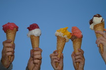 hands holding up waffle cones
