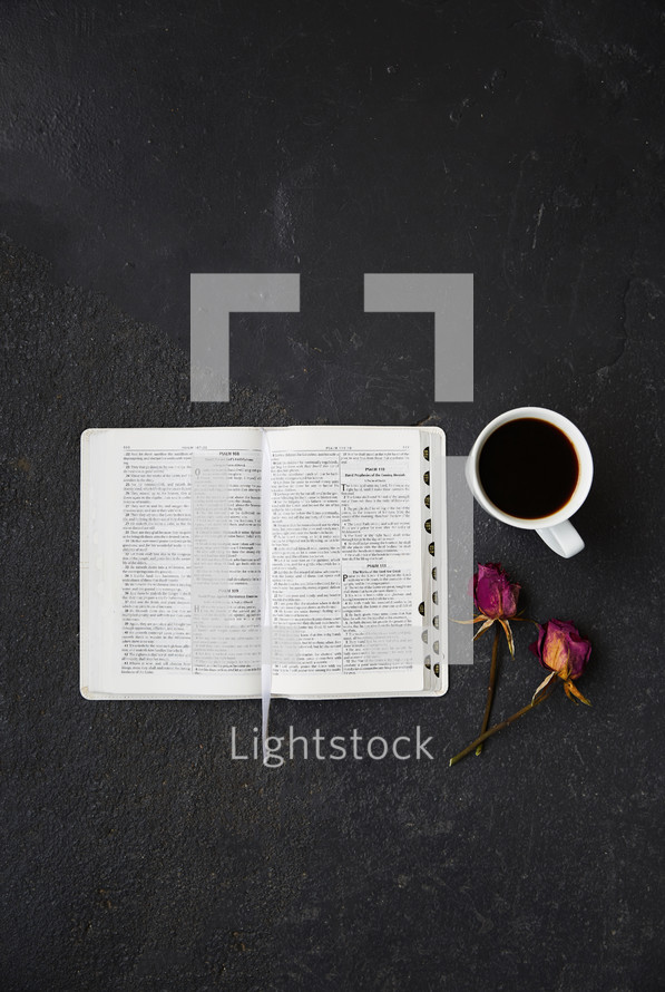 open Bible, dried roses and coffee cup