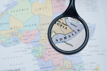 magnifying glass over a map of Somalia