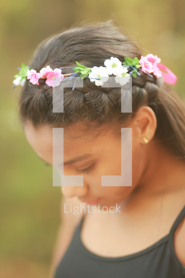 a teen girl with a crown of flowers in a her hair