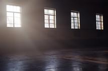 sunlight shining through a window onto a floor