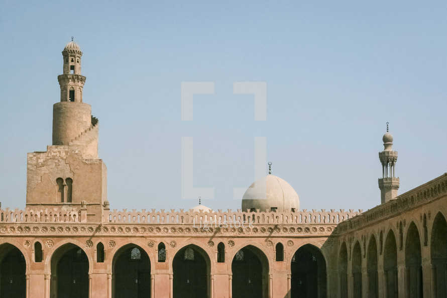 tower, dome, and courtyard of a mosque in Egypt