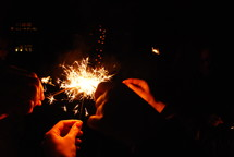 Celebrating New Years with sparklers.
