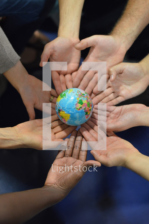 ínternational group holding a globe together.