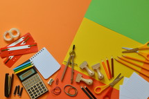 School supplies on colorful paperboard