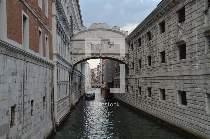 Bridge of Sighs over a canal in Venice