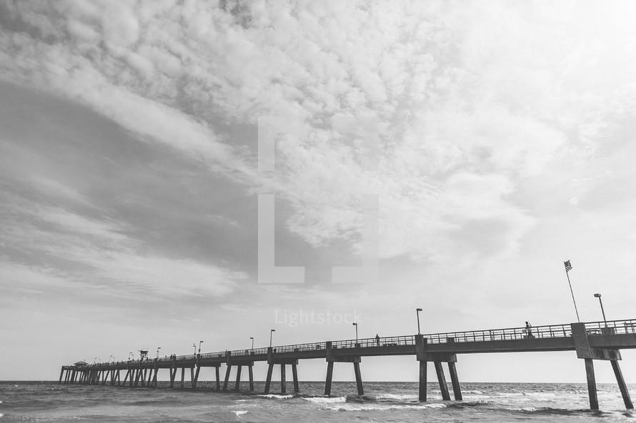 An long ocean pier.