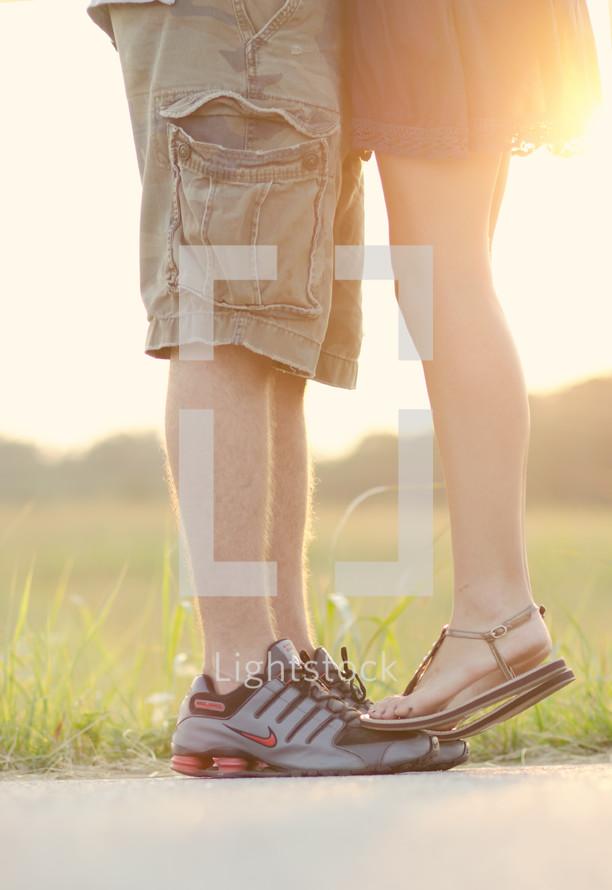 woman standing on a man's feet