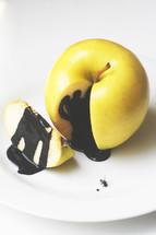 black tar on an apple