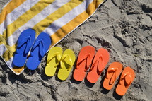 family summer vacation. family, summer, vacation, beach, sand, ocean, swimming pool, swim, swimming, free, free time, summertime, holiday, holidays, families, fun, sun, happy, colorfully, colorful, color, multicolored, blue, red, yellow, orange, flip flop, sandal, sandals, bathing shoe, bathing shoes, shoe, shoes, bathing, bath, thong, thongs, beach slide, beach slides, play, playing, relax, relaxing, chill, chilling, towel, size, different, various, father, mother, child, children