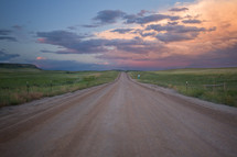 rural dirt road at sunset