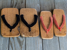 Sandals on a wood deck.