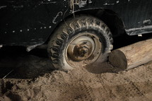 deadlocked – a car off-road on rough terrain.  deadlocked, car, wheel, stuck, got stuck, sand, deep, gridlocked, stalemate, impasse, standstill, dead end, dug in, dig, digging, stick, sticking, stranded, wheels, wedged, marooned, spin, spinning, wheelspin, road, path, off-road, tire, tyre, vehicle, cross-country, country, ground, grounds, area, pathless, difficult, wayless, impassable, sink, bog down, bogged, descend, hopeless, desperate, desolate, hopelessly, wheeler, vessel, craft, automobile