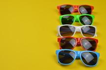 sunglasses on yellow