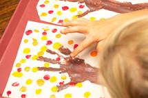 child finger-painting
