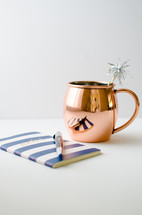 copper pitcher and journal