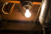 glowing lightbulb in an attic