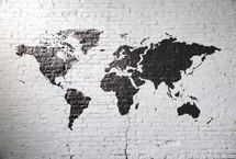 world map on a white brick wall.