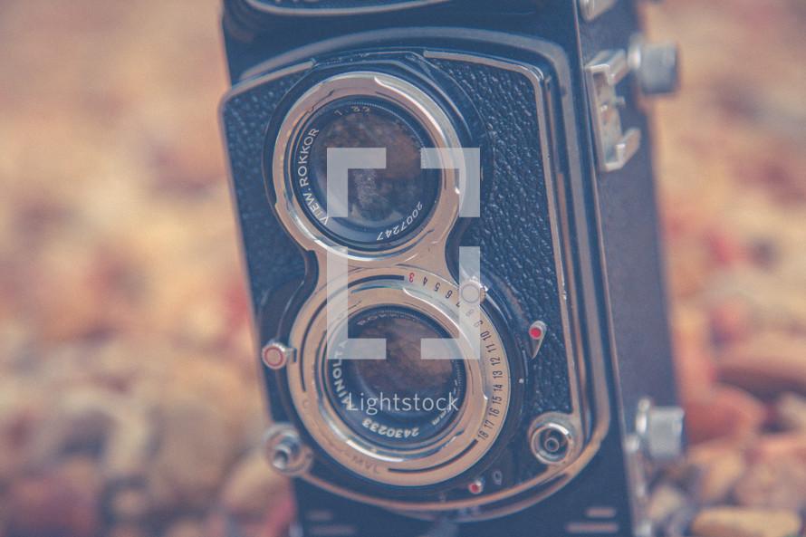 vintage camera in rocks