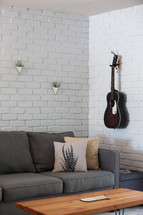 guitar on a wall in a living room