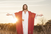 Jesus Christ with outstretched arms. He is Risen.