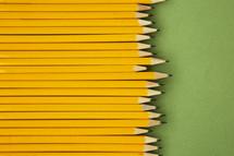 row of sharpened pencils