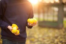 a man carrying lemons