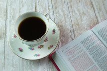 pink Bible and floral print coffee cup