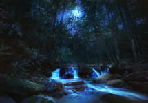 flowing river and cascading waterfall under moonlight
