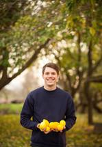 a man holding lemons outdoors