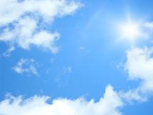 sunburst in a blue sky