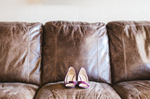 heels on a leather couch