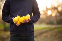 a man holding lemons