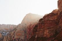 fog rising over red rock peaks