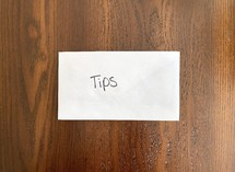 tips - money in an envelope
