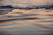 tide washing onto wet sand