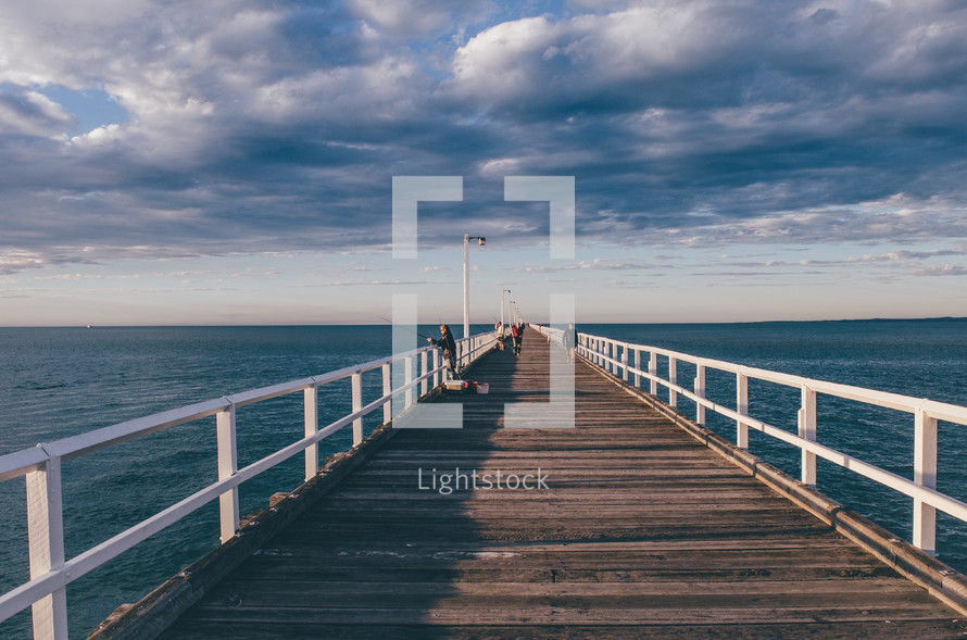 A pier going out into the bay at dusk.