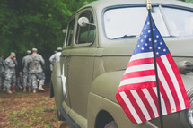 soldiers and American flag on a military police vehicle