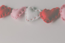 stitched felt hearts on a white background
