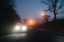 bicycle headlights on a road at night