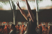 a man with raised hands at a concert