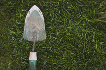 a shovel in the grass