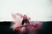 a woman with a smoke flare