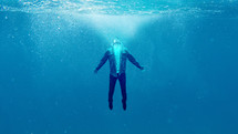 a glowing man under water, rising up, baptism