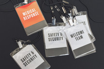 welcome team, medical response, and security badges