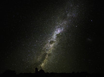 galaxy above a telescope at an observatory