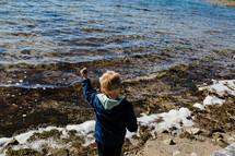 a child skipping rocks